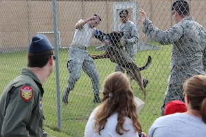 Military Working Dog Ooleg bites Staff Sgt. Zachary Kunkler, 14th Security Forces Squadron MWD handler, during a demonstration May 15, 2018, at Columbus Air Force Base, Mississippi. The demonstration was a part of the National Police Week 2018, which is a week set aside to recognize security forces and local law enforcement. (U.S. Air Force photo by Airman 1st Class Beaux Hebert)