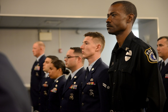 Airmen from the 14th Security Forces Squadron stand during the Fallen Defender's Memorial May 16, 2018, on Columbus Air Force Base, Mississippi. (U.S. Air Force photo by Airman 1st Class Keith Holcomb)