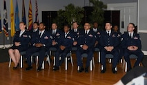 Eleven Team BLAZE members wait to receive their Community College of the Air Force degree May 10, 2018 on Columbus Air Force Base, Mississippi. With a CCAF degree, Airmen have a better chance to rank up and progress further in their career.