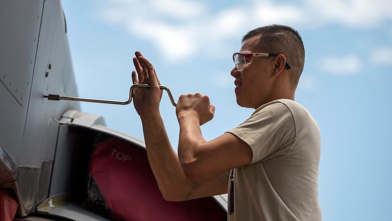 An aircraft maintenance crewmember unscrews a KC-135 Stratotanker aircraft panel during a 900-hour inspection at MacDill Air Force Base, Fla., May 16, 2018. During this inspection, maintenance crewmembers perform major and minor servicing to the aircraft's structure. MacDill's contribution to global mobility is possible because of the maintenance Airmen who dedicate countless hours to ensure aircraft are fit for flight.