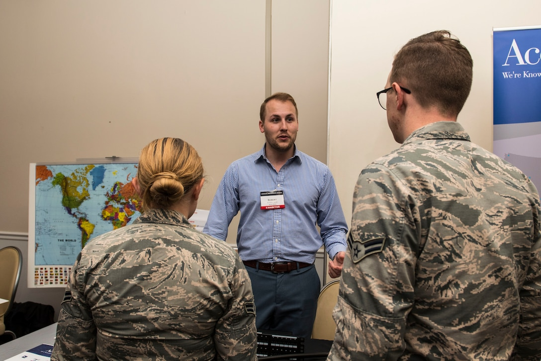 A company representative talks to Airmen about his company's technology during a technology exposition at Shaw Air Force Base, S.C., May 16, 2018.