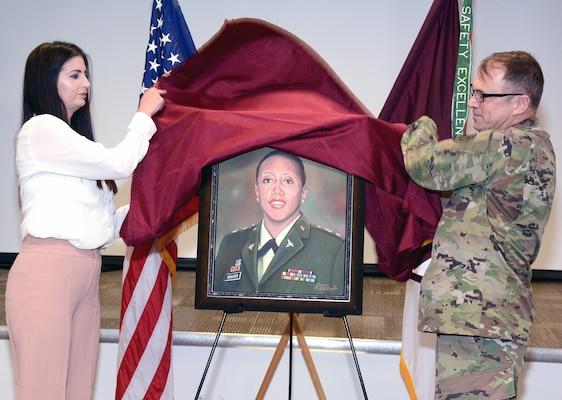 Kourtney Valdez (left), daughter of Richard Valdez, and Maj. Gen. Brian C. Lein, commanding general, U.S. Army Medical Department Center & School, unveil the painting of Lt. Col. Karen Wagner.