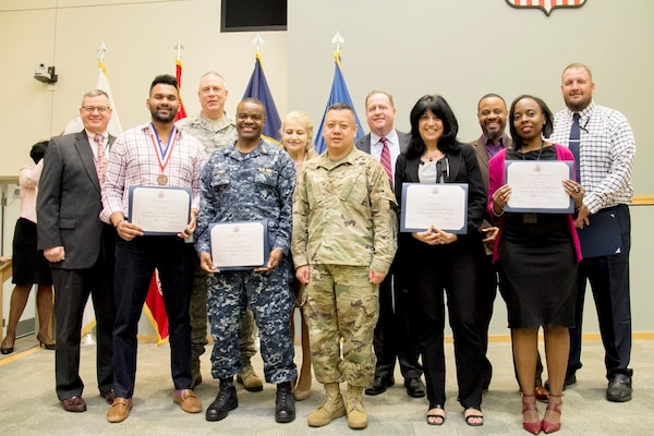 DLA Troop Support winners and nominees from the 2017 Federal Executive Board Executive Board Excellence in Government Awards pose with Troop Support Deputy Commander Richard Ellis (far left) in Philadelphia on May 17.