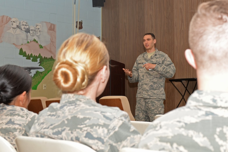 Capt. Raidel Leon-Martinez, a 28th Bomb Wing chaplain, talks to Airmen at the 28th Communications Squadron building about having boundaries and taking care of themselves at Ellsworth Air Force Base, S.D., May 9, 2018. The wing's chapel team paired up with the mental health clinic to help Airmen express anything going on in their lives and to know the avenues they have access to. (U.S. Air Force photo by Airman 1st Class Nicolas Z. Erwin)
