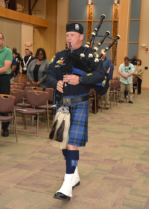 Officer plays bagpipe