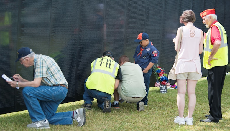 Visitors at The Wall That Heals look for names on the memorial in Camden, S.C., May 5, 2018.
