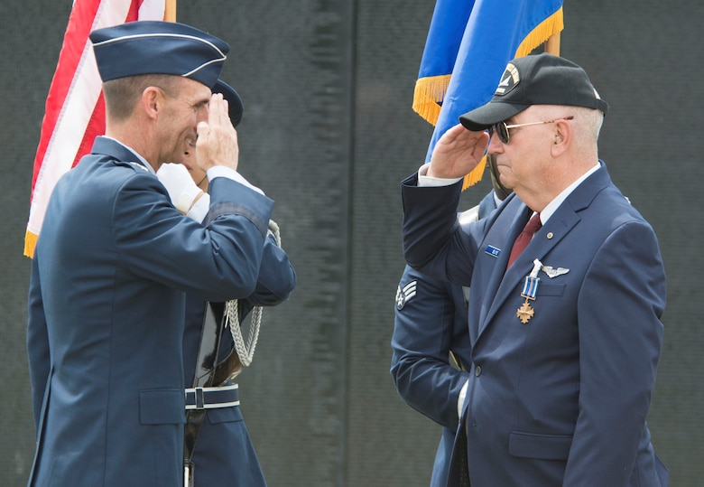 U.S. Air Force Maj. Gen. Scott Zobrist, 9th Air Force commander, returns a salute from retired Capt. Johnny Blye at The Wall That Heals in Camden, S.C., May 5, 2018.