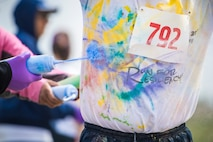 Team Minot families participated in a color run at Minot Air Force Base, N.D., May 17, 2018.  The 5th Medical Group's Health and Wellness Center teamed up with the base's master resiliency trainer to host the resiliency-themed event.  More than 100 individuals ran the course that consisted of six color stations spanning the two, five and 10 km routes. (U.S. Air Force photo by Senior Airman J.T. Armstrong)