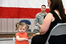 Maj. Wade Smith's daughter poses for a photo during a 94th Aircraft Maintenance Squadron assumption-of-command ceremony held at Dobbins Air Reserve Base, Ga. on May 5, 2018. Smith has been at Dobbins since last summer, when he took a position as operations officer for the 94th Maintenance Squadron. (U.S. Air Force photo/Senior Airman Josh Kincaid)