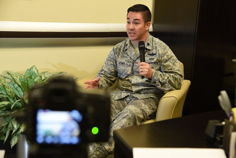 Lt. Col. David Fink, Air Force District of Washington command post director, responds to a mock reporter's questions during media training at the 2018 AFDW Squadron Commanders Course in the Gen. Jacob E. Smart Conference Center here May 15.
