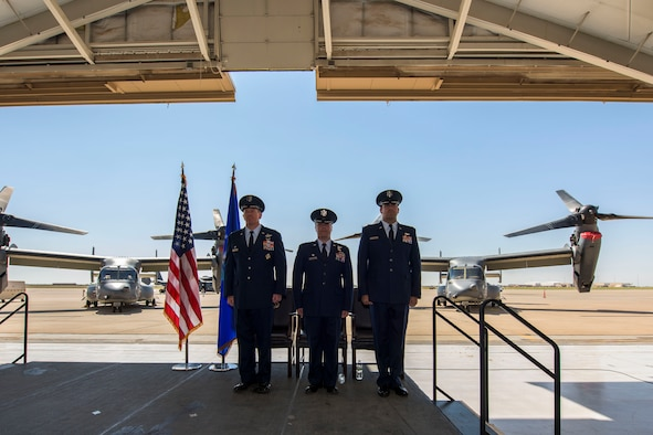 Col. Michael A. Jackson, 27th Special Operations Group commander, left, Lt. Col. Jeremy S. Bergin, previous 20th Special Operations Squadron commander, middle, and Lt. Col. Charles W. Mauze, new 20th SOS commander, stand at attention during the 20th SOS change of command ceremony May 18, 2018, at Cannon Air Force Base, N.M. Jackson was the presiding officer for the ceremony to exchange the command of the 20th SOS from Bergin to Mauze. (U.S. Air Force photo by Senior Airman Luke Kitterman/Released)