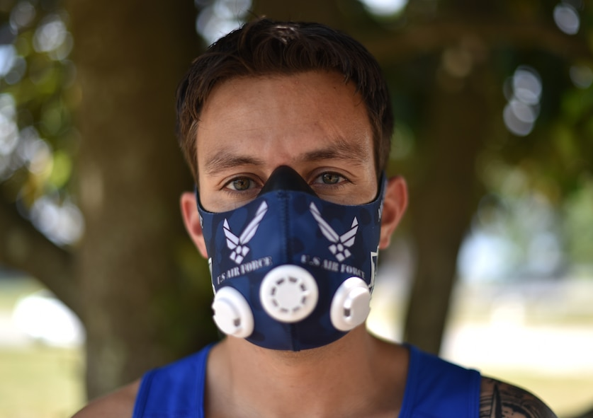 U.S. Air Force Wounded Warrior Master Sgt. Kenneth Guinn, 325th Civil Engineering Squadron Explosive Ordnance Disposal Logistics section chief, wears an elevation training mask at Tyndall Air Force Base, Fla., May 15, 2018.  The mask helps prepare him to compete in the higher elevation levels of Colorado, where the 2018 Warrior Games is scheduled to take place. (U.S. Air Force photo by Airman 1st Class Delaney Gonzales/Released)