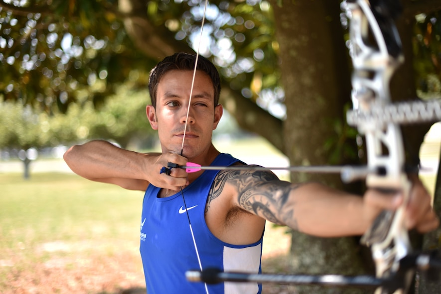 U.S. Air Force Wounded Warrior Master Sgt. Kenneth Guinn, 325th Civil Engineering Squadron Explosive Ordnance Disposal Logistics section chief, readies an arrow on a recurve bow at Tyndall Air Force Base, Fla., May 15, 2018. Guinn was selected to participate in the 2018 Warrior Games for track, field, archery, power-lifting, sitting volley ball and wheelchair basketball. (U.S. Air Force photo by Airman 1st Class Delaney Gonzales/Released)