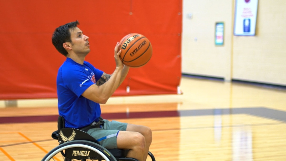 U.S. Air Force Wounded Warrior Master Sgt. Kenneth Guinn, 325th Civil Engineering Squadron Explosive Ordnance Disposal Logistics section chief, practices wheelchair basketball at Tyndall Air Force Base, Fla., May 15, 2018. Guinn was selected to participate in the 2018 Warrior Games for track, field, archery, power-lifting, sitting volley ball and wheelchair basketball. (U.S. Air Force photo by Senior Airman Tybee Hurst/Released)