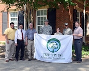 Col. Anthony Sansano, 14th Mission Support Group commander, and members of the 14th Civil Engineer Squadron receive a Tree City USA award May 15, 2018 on Columbus Air Force Base, Mississippi. Columbus AFB is one of a few arboretums in Mississippi. (U.S. Air Force photo by Sharon Ybarra)