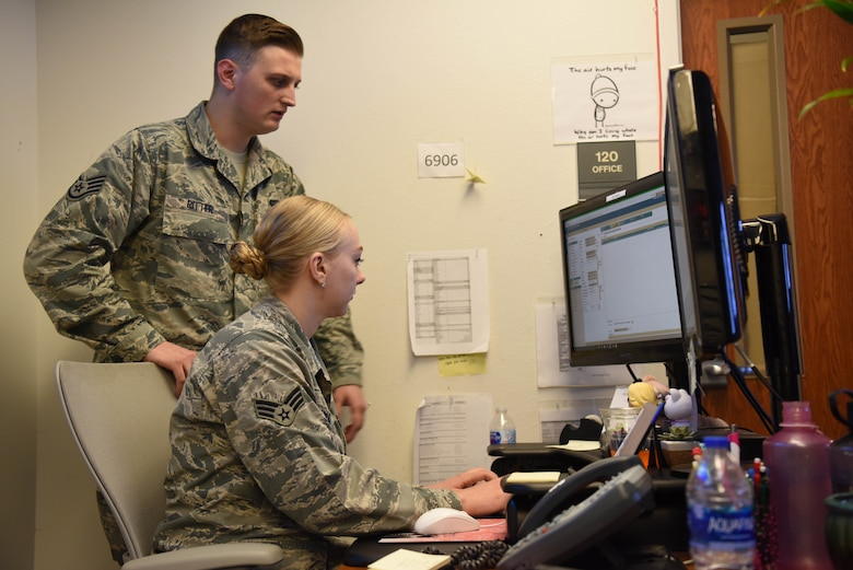 Senior Airman Skyler Vinay, a 28th Communications Squadron cyber transport systems technician and Staff Sgt. Sebastian Ritter, 28th CS Communications Focal Point noncommissioned officer in charge, inspect a computer during the Cyber Storm exercise at Ellsworth Air Force Base, S.D., May 14, 2018. Cyber Storm is in its second year and is used to help the 28th CS find cybersecurity weaknesses and be more effective in a cyber-contested environment. (U.S. Air Force photo by Airman 1st Class Thomas Karol)