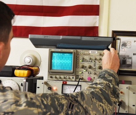 Airman 1st Class Mason Kitchens, a 28th Communications Squadron radio frequency transmission systems technician, uses an oscilloscope, which is a device used to see changes in an electrical signal over time during the Cyber Storm exercise at Ellsworth Air Force Base, S.D., May 14, 2018. Cyber Storm is in its second year and is used to help the 28th CS find cybersecurity weaknesses so they can be more effective in a cyber-contested environment. (U.S. Air Force photo by Airman 1st Class Thomas Karol)