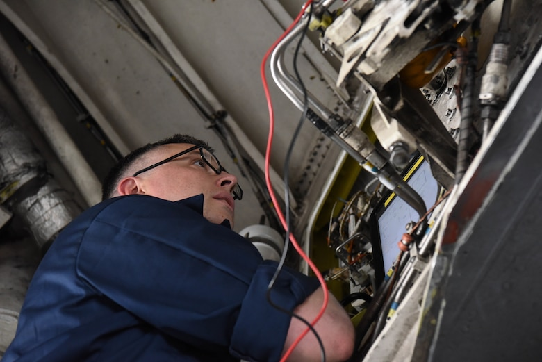 Tech. Sgt. Timothy Kenny, a 28th Aircraft Maintenance Squadron aircraft electrical environmental craftsman, inspects an aircraft part with the help of a technical order during Combat Raider 18-2 at Ellsworth Air Force Base, S.D., May 14, 2018. Combat Raider is a joint exercise that involves multiple airframes from different bases to prepare Airmen and the Air Force for potential future conflicts. (U.S. Air Force photo by Airman 1st Class Thomas Karol)