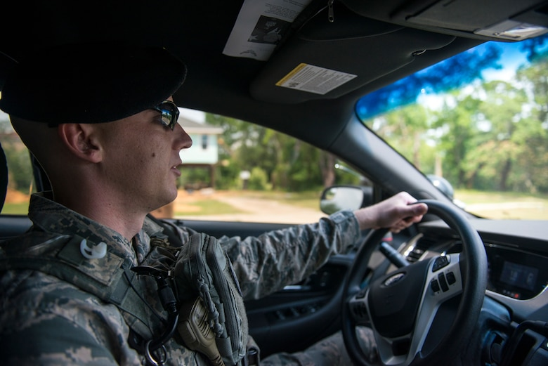 Tech. Sgt. Jarrod Kinard, 81st Security Forces Squadron flight chief, patrols the perimeter during a ride-along at Keesler Air Force Base, Miss., May 17, 2018. The ride-along program is part of the 81st SFS community involvement initiative where anyone, age 15 and up and with base access, can see what it's like to be a defender. If you are interested in the ride-along program, please contact Tech. Sgt. Matthew Oleson at 228-376-6601. (U.S. Air Force photo by Senior Airman Travis Beihl)