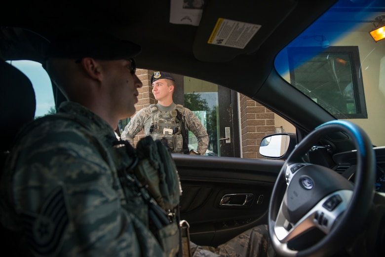 Tech. Sgt. Jarrod Kinard, 81st Security Forces Squadron flight chief, checks in on Airman Hunter Harris, 81st SFS entry controller, during a ride-along at Keesler Air Force Base, Miss., May 17, 2018. The ride-along program is part of the 81st SFS community involvement initiative where anyone, age 15 and up and with base access, can see what it's like to be a defender. If you are interested in the ride-along program, please contact Tech. Sgt. Matthew Oleson at 228-376-6601. (U.S. Air Force photo by Senior Airman Travis Beihl)