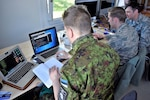 Maryland Guard cyber warfare operators from the 175th Wing's Cyber Operations Group support Exercise Hedgehog May 7, 2018, in Southern Estonia. The Cyber personnel advise and assist Estonian Defense Force and Estonia Defense League members to evaluate internal policy for cyber-related activities.