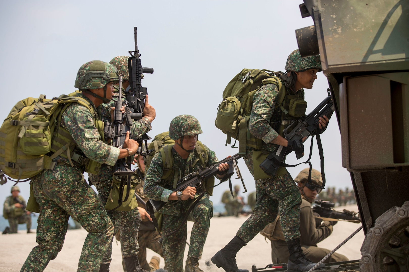 U.S. Marines assigned to 2nd Battalion, 8th Marine Regiment and Philippine Marines with 10th Marines Company ride in an assault amphibious vehicle during an amphibious landing exercise at the Navy Education and Training Command in San Antonio, Zambales, May 9, 2018 during Exercise Balikatan. This training is held to further interoperability between the U.S. and the Philippines while conducting amphibious exercises. Exercise Balikatan, in its 34th iteration, is an annual U.S.-Philippine military training exercise focused on a variety of missions, including humanitarian assistance and disaster relief, counterterrorism and other combined military operations held from May 7 to 18. (U.S. Marine Corps photo by Cpl. Charles Plouffe)
