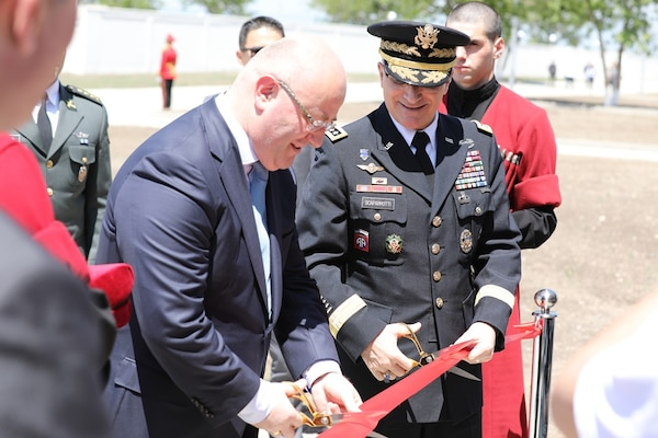 Georgian Defense Minister Levan Izoria and Army Gen. Curtis M. Scaparrotti, commander of U.S. European Command, cut the ceremonial ribbon during a launch ceremony for the Georgia Defense Readiness Program Training initiative at the Georgian armed forces' Vaziani military base in Georgia, May 18, 2018. The initiative reaffirms U.S. commitment to Georgia's sovereignty and aspirations to become a member of NATO, Eucom officials said. U.S. Embassy Tbilisi photo