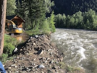 Flood teams from U.S. Army Corps of Engineers strengthened a section of the Lost River levee in Mazama, Wash.