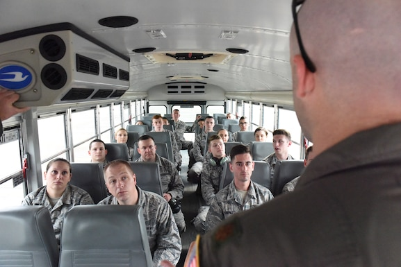 Maj. Michael Glass, a pilot with the 193rd Special Operations Wing, Middletown, Pennsylvania, gives a safety briefing to Airmen selected to participate in an incentive flight May 20, 2018. Incentive flights are a way to highlight outstanding Airmen's accomplishments as well as provide mission-required raining for aircrew. (U.S. Air National Guard photo by Senior Airman Julia Sorber/Released)