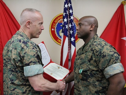 U.S. ARMY GARRISON, YONGSAN – Lt. Col. Daniel J. Thomas (right), U.S. Marine Corps Forces Korea G3 future operations officer, is awarded the Navy and Marine Corps Commendation Medal by Maj. Gen. Patrick J. Hermesmann, MARFORK commander, here, May 11. Thomas, who will report to 4th Marines, was awarded for his outstanding contribution to the command in leading both future operations development and the setup of MARFORK's future move to Camp Humphreys. (Official U.S. Marine Corps Photo by Sgt. Nathaniel Hanscom/Released)