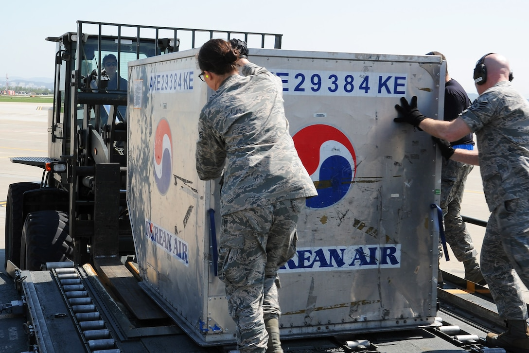 Personnel assigned to the 731st Air Mobility Squadron and 67th Aerial Port Squadron at Hill Air Force Base, Utah unload a Korean Air baggage container during the Mutual Airlift Support Agreement (MASA) exercise at Osan Air Base, Republic Of Korea May 4, 2018. The MASA demonstrates the alliance between the United States and ROK, which enabled the 731st AMS to process passengers and load personnel baggage onto a Korean commercial aircraft. (U.S. Air Force photo by Tech. Sgt. Ashley Tyler)