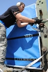 U.S. Air Force Staff Sgt. Tony Band, 731st Air Mobility Squadron aircraft services supervisor, straps down a Korean Air baggage container before loading personnel baggage, during the Mutual Airlift Support Agreement (MASA) exercise at Osan Air Base, Republic Of Korea May 4, 2018. The MASA demonstrates the alliance between the United States and ROK, which enabled the 731st AMS to process passengers and load personnel baggage onto a Korean commercial aircraft. (U.S. Air Force photo by Tech. Sgt. Ashley Tyler)