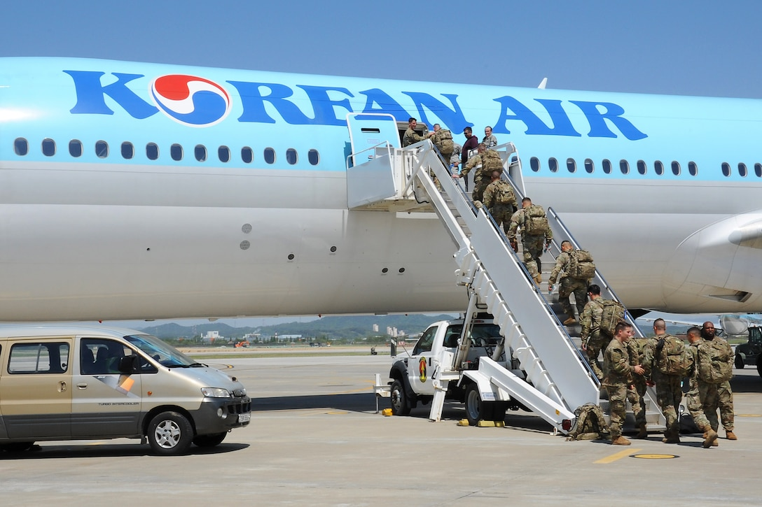 U.S. Army Soldiers board a Korean Air Boeing 777 aircraft during the Mutual Airlift Support Agreement (MASA) exercise at Osan Air Base, Republic of Korea May 4, 2018. More than 500 Soldiers boarded the plane as part of the MASA to test interoperability and procedures between the United States military, ROK Air Force and Korean Air Lines. (U.S. Air Force photo by Tech. Sgt. Ashley Tyler)