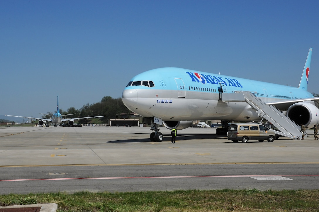 Two Korean Air Boeing 777 aircraft sit on the flightline during the Mutual Airlift Support Agreement (MASA) exercise at Osan Air Base, Republic of Korea May 4, 2018. Close coordination between U.S. Transportation Command at Scott Air Force Base, Illinois, the ROK Air Force, U.S. Forces Korea, Korean Air and the Osan Air Base team was required to accomplish the transport of more than 500 Soldiers to exercise Balikatan in the Philippines. (U.S. Air Force photo by Tech. Sgt. Ashley Tyler)