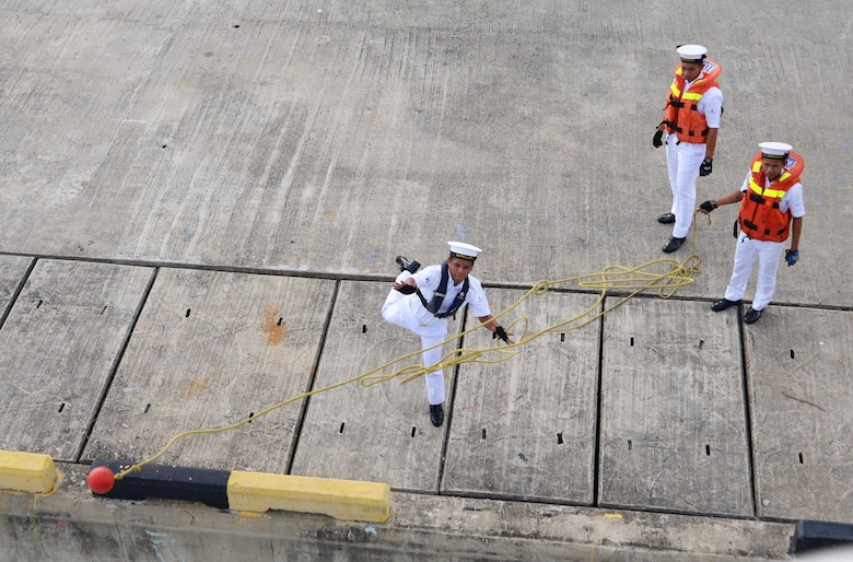 Royal Malaysian Navy sailors heave the lines to USNS Millinocket (T-EPF 3) crewmembers as the ship arrives in Seppangar Naval Base as part of a U.S. 7th Fleet theater security cooperation patrol. Millinocket will visit several countries in the Indo-Pacific in the coming weeks.