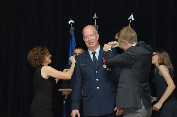 Air Force Col. Joel Carey, 12th Flying Training Wing commander, is promoted to the rank of brigadier general, May 18, 2018, Joint Base San Antonio-Randolph, Texas. The 12FTW is responsible for four single-source aviation pipelines – Pilot Instructor Training, Combat Systems Officer Training, Remotely Piloted Aircraft Pilot Indoctrination, and Basic Sensor Operator Qualification. (U.S. Air Force photo by Joel Martinez)