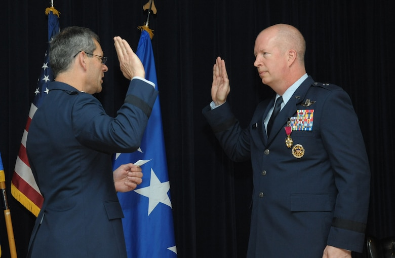 Lt. Gen. Kenneth Wilsbach, commander of Alaskan North American Aerospace Defense Command Region, Alaskan Command, U.S. Northern Command, and Eleventh Air Force, promotes Col. Joel Carey to the rank of brigadier general, May 18, 2018, Joint Base San Antonio-Randolph, Texas.  The 12FTW is responsible for four single-source aviation pipelines – Pilot Instructor Training, Combat Systems Officer Training, Remotely Piloted Aircraft Pilot Indoctrination, and Basic Sensor Operator Qualification. (U.S. Air Force by Joel Martinez)