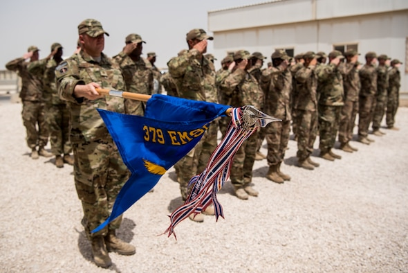 Airmen from the 379th Expeditionary Security Forces Squadron take time to remember the sacrifices of fallen security forces members during a fallen defender memorial ceremony at Al Udeid Air Base, Qatar, May 18, 2018. The ceremony, taking place during National Police Week 2018, was one of the week's many events in addition to a 24-hour remembrance walk, a law enforcement tactics demonstration, a military working dog competition and a 5K ruck. (U.S. Air Force Photo by Staff Sgt. Joshua Horton)