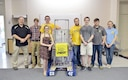 The Central Magnet Robotics team, with Central Magnet School in Murfreesboro, stopped in at the Hands-On Science Center (HOSC) in Tullahoma May 1 to provide a demonstration of their robot's capabilities for Air Force STEM director Olga Oakley. Pictured left to right: Marc Guthrie, Drew Dove, Ethan Davenport, Maddy Perrien, Aidan Gibson, David Schafer, Jimmy Jones and Olga Oakley. (U.S. Air Force photo/Christopher Warner)