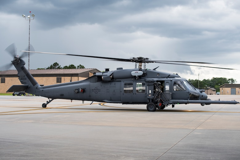 A special missions aviator from the 41st Rescue Squadron looks out the window of an HH-60G Pave Hawk while taxing on the flightline, May 17, 2018, at Moody Air Force Base, Ga. Airmen conduct routine training missions in the airspace surrounding Moody to remain current on their tactics and procedures. While helping pilots remain proficient, training also gives crew chiefs and maintainers the opportunity to remain proficient at launching and maintaining the aircraft. (U.S. Air Force photo by Senior Airman Janiqua P. Robinson)