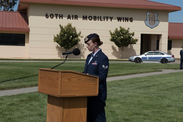 Staff Sgt. Elisabeth Shafer, 60th Security Forces Squadron installation patrolman, serves as the emcee for the Police Week Retreat Ceremony May 18, 2018 at Travis Air Force Base, Calif. The ceremony closed out Police Week observances for Travis and featured a roll call for 27 fallen Airmen, the playing of Taps and the ceremonious folding of the American flag. (U.S. Air Force photo by Tech. Sgt. James Hodgman)