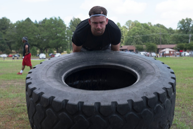 Man flips tire.