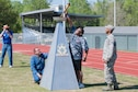 Arnold Air Force Base Staff Sgt. Richard Griffin participates in the lighting of the Special Olympics torch with athlete Darius Battles at the Area 13 Special Olympics on May 1 at the Tullahoma High School stadium. (U.S. Air Force photos/Jacqueline Cowan)