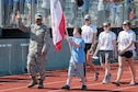 Arnold Air Force Base Staff Sgt. Richard Griffin marches in the procession with the teams at the Area 13 Special Olympics on May 1 at the Tullahoma High School stadium. (U.S. Air Force photos/Jacqueline Cowan)