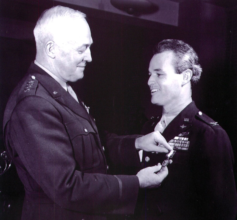 Col Philip Cochran is decorated by Gen. Henry 'Hap' Arnold, Air Force chief of staff.
