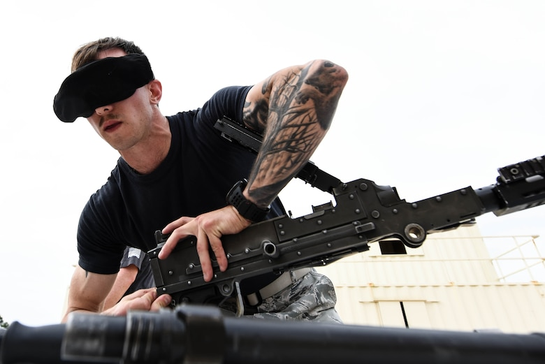 U.S. Air Force Staff Sgt. Ryan Libbon, 20th Security Forces Squadron installation patrolman, disassembles a cleared M240 machine gun while blindfolded during the National Police Week defender challenge at Shaw Air Force Base, S.C., May 15, 2018.