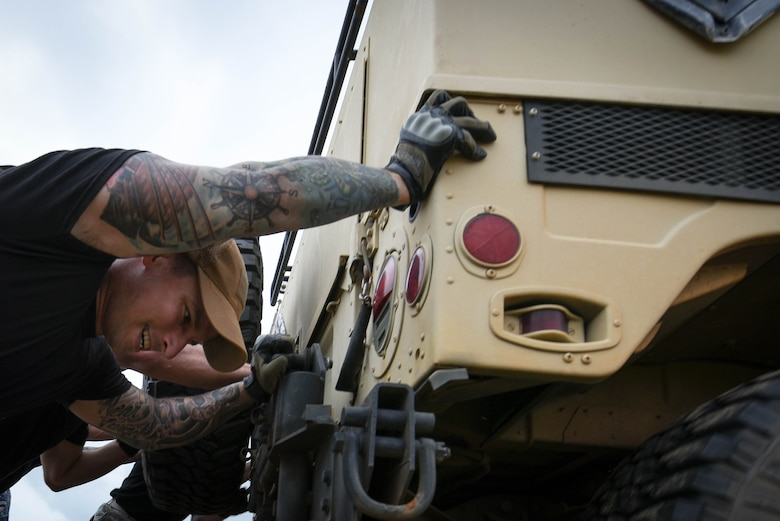 U.S. Air Force Staff Sgt. Patrick Formiller, 20th Security Forces Squadron flight sergeant, pushes a Humvee during the National Police Week Defenders Challenge at Shaw Air Force Base, S.C., May 15, 2018.