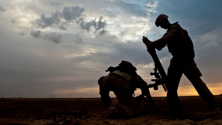 Coalition forces prepare to fire a mortar during military operations near the Iraq-Syria border.