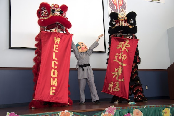 The Mt. Song Martial Arts Academy of Tampa performs a Chinese Lion Dance during the Asian American Pacific Islander Heritage Month celebration at MacDill Air Force Base, Fla., May 17, 2018. The Lion Dance is performed alongside a musician playing a large drum that follows the moves and roar of the lion. This performance is to bring peace and good fortune. (U.S. Air Force photo by Airman 1st Class Ashley Perdue)
