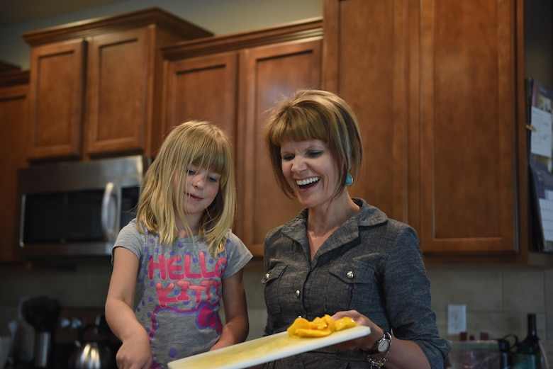 Jodi Novak, cancer survivor, cooks with her daughter Bethany May 14, 2018, in Parker, Colorado. Novak has two daughters, Bethany and Abigail Novak. (U.S. Air Force photo by Airman 1st Class Michael D. Mathews)